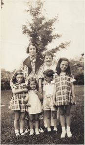 Mom and her brothers and sisters and Aunt Irene. Mom is the one pulling her little sister's hair.